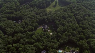 AX75_168 - 5K stock footage aerial video tilting to a bird's eye view of a beautiful home with pool in Fairfax Station, Virginia