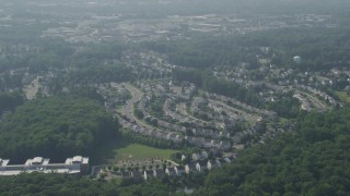 AX75_169 - 5K stock footage aerial video of suburban homes on curved streets in Manassas, Virginia