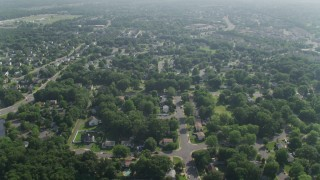 AX75_172 - 5K stock footage aerial video flying over a suburban residential neighborhood in Manassas, Virginia