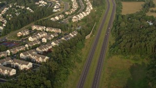 AX76_001 - 5K stock footage aerial video of Prince William Parkway, residential neighborhoods, Manassas, Virginia, sunset