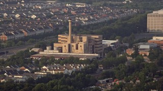 AX76_023 - 5K stock footage aerial video of Covanta Energy Corporation power plant, Alexandria, Virginia, sunset
