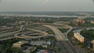 AX76_030 - 5K stock footage aerial video of Interstate 95, Richmond Highway interchange, Alexandria, Virginia, sunset