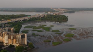 AX76_031 - 5K stock footage aerial video of Woodrow Wilson Memorial Bridge, Potomac River, Fort Washington, Maryland, sunset