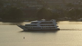AX76_034 - 5K stock footage aerial video tracking a ferry sailing the Potomac River, Alexandria, Virginia, sunset