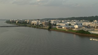 AX76_035 - 5K stock footage aerial video flying by United States Naval Research Laboratory, Washington, D.C., sunset
