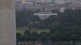 AX76_047 - 5K stock footage aerial video flying by The White House and Washington Monument, Washington D.C., sunset