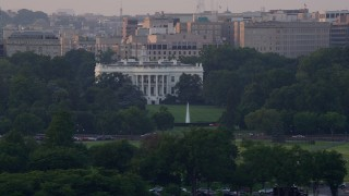 AX76_048 - 5K stock footage aerial video flying by The White House, Washington D.C., sunset