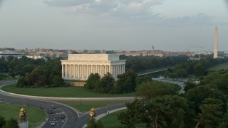 AX76_051 - 5K stock footage aerial video Lincoln Memorial, Reflecting Pool, Washington Monument, National Mall, Washington D.C., sunset