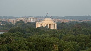AX76_059 - 5K stock footage aerial video approaching the Jefferson Memorial with tourists, Washington D.C., sunset