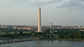 AX76_061 - 5K stock footage aerial video of Washington Monument seen from Tidal Basin, Washington D.C., sunset