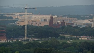 AX76_071 - 5K stock footage aerial video of Smithsonian Castle in Washington D.C., sunset