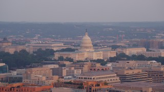 AX76_080 - 5K stock footage aerial video flying by the United States Capitol, Washington D.C., sunset