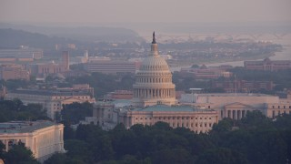 AX76_084 - 5K stock footage aerial video of the United States Capitol and the Rayburn Office Building in Washington D.C., sunset