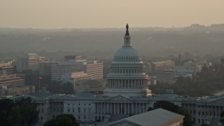 AX76_089 - 5K stock footage aerial video of the United States Capitol, revealing Washington Monument, Washington D.C., sunset
