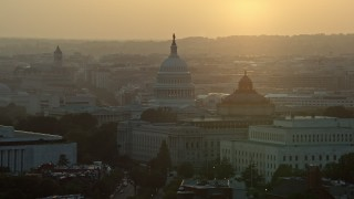 AX76_095 - 5K stock footage aerial video of the United States Capitol, Thomas Jefferson and John Adams buildings, Washington D.C., sunset