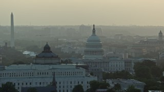 AX76_096 - 5K stock footage aerial video Library of Congress, United States Capitol, Washington Monument, Supreme Court, Washington D.C., sunset