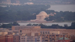 AX76_107 - 5K stock footage aerial video of tourists at the Jefferson Memorial in Washington D.C., sunset