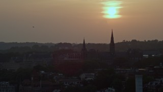 AX76_109 - 5K stock footage aerial video of Georgetown University in Washington D.C., setting sun in background