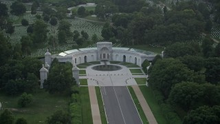 AX76_113 - 5K stock footage aerial video of the Women in Military Service for America Memorial, Arlington National Cemetery, Virginia, twilight