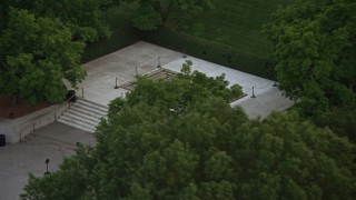 AX76_115 - 5K stock footage aerial video of President John F. Kennedy Gravesite at the Arlington National Cemetery, Arlington, Virginia, twilight