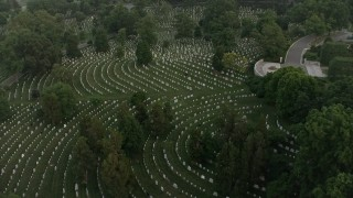 AX76_119 - 5K stock footage aerial video flying over Arlington National Cemetery gravestones, Arlington, Virginia, twilight