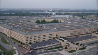 AX76_124 - 5K stock footage aerial video orbiting The Pentagon, Washington, D.C., twilight