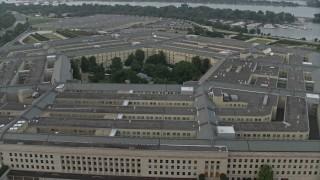 AX76_124E - 5K stock footage aerial video orbiting The Pentagon, Washington, D.C., twilight