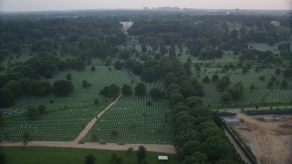 AX76_126 - 5K stock footage aerial video flying by Arlington National Cemetery, Arlington, Virginia, twilight