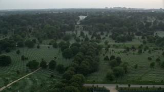 AX76_126E - 5K stock footage aerial video flying by Arlington National Cemetery, Arlington, Virginia, twilight