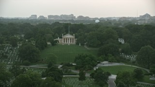 AX76_128 - 5K stock footage aerial video of Arlington House and John F. Kennedy Gravesite at Arlington National Cemetery, Virginia, twilight