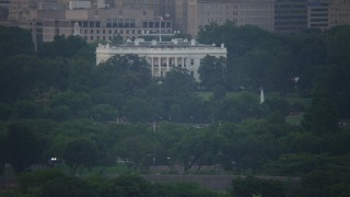 AX76_131 - 5K stock footage aerial video flying by The White House in Washington, D.C., twilight