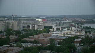 AX76_137 - 5K stock footage aerial video approaching Nationals Park stadium in Washington, D.C., twilight