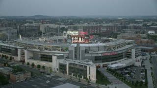 AX76_138 - 5K stock footage aerial video flying by Nationals Park, crowded with spectators, Washington, D.C., twilight