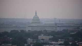 AX76_140 - 5K stock footage aerial video of the United States Capitol dome and James Madison Building in Washington, D.C., twilight