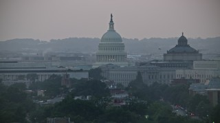 AX76_142 - 5K stock footage aerial video of the United States Capitol dome between the James Madison and Thomas Jefferson Buildings in Washington, D.C., twilight