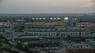 AX76_144 - 5K stock footage aerial video approaching Nationals Park from the Anacostia River during a baseball game, Washington, D.C., twilight