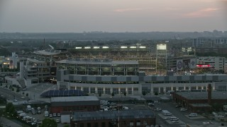 AX76_145 - 5K stock footage aerial video flying by Nationals Park during a baseball game, Washington, D.C., twilight