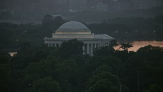 AX76_148 - 5K stock footage aerial video lying by the Jefferson Memorial, Washington, D.C., twilight