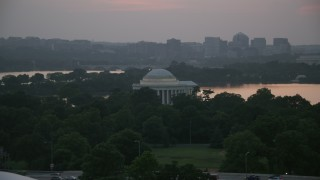 AX76_149 - 5K stock footage aerial video of the Jefferson Memorial beside Tidal Basin in Washington, D.C., twilight