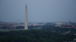 AX76_153 - 5K stock footage aerial video of the Washington Monument, National Mall, United States Capitol, Lincoln Memorial, Washington, D.C., twilight