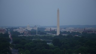 AX76_154 - 5K stock footage aerial video of the United States Capitol, Washington Monument, National Mall, Washington, D.C., twilight