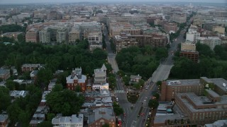 AX76_156 - 5K stock footage aerial video of Pennsylvania Avenue and M Street, Georgetown, Washington, D.C., twilight