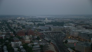 AX76_163 - 5K stock footage aerial video of United States Capitol with Potomac River in the background, Washington, D.C., twilight