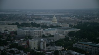 AX76_165 - 5K stock footage aerial video of the United States Capitol behind the Russell, Dirksen and Hart Senate Office Buildings, Washington, D.C., twilight