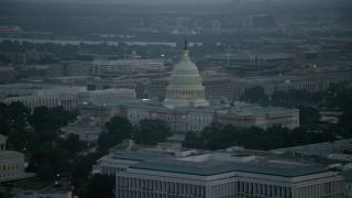 AX76_166 - 5K stock footage aerial video of the United States Capitol building in Washington, D.C., twilight