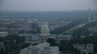 AX76_167 - 5K stock footage aerial video of United States Capitol, Washington Monument, and the Thomas Jefferson Building, Washington, D.C., twilight
