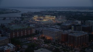 AX76_170 - 5K stock footage aerial video approaching Nationals Park during a baseball game, Washington, D.C., twilight