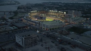 AX76_170E - 5K stock footage aerial video approaching Nationals Park during a baseball game, Washington, D.C., twilight
