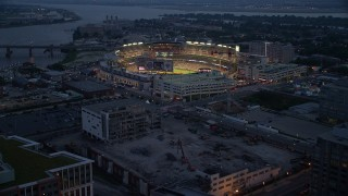 AX76_171 - 5K stock footage aerial video approaching Nationals Park during a baseball game, Washington, D.C., twilight