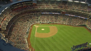 AX76_172E - 5K stock footage aerial video flying by a baseball game at Nationals Park, Washington, D.C., twilight